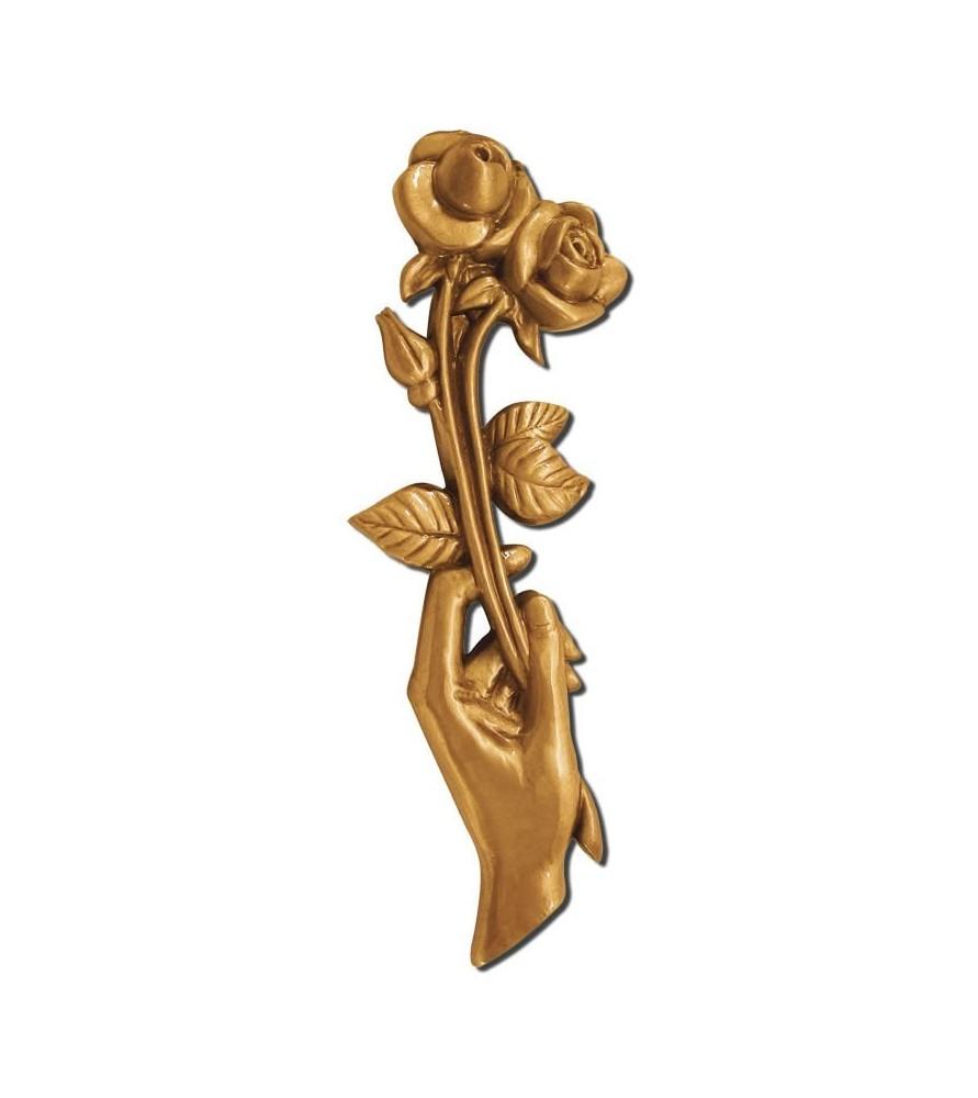 Mano con flor bronce